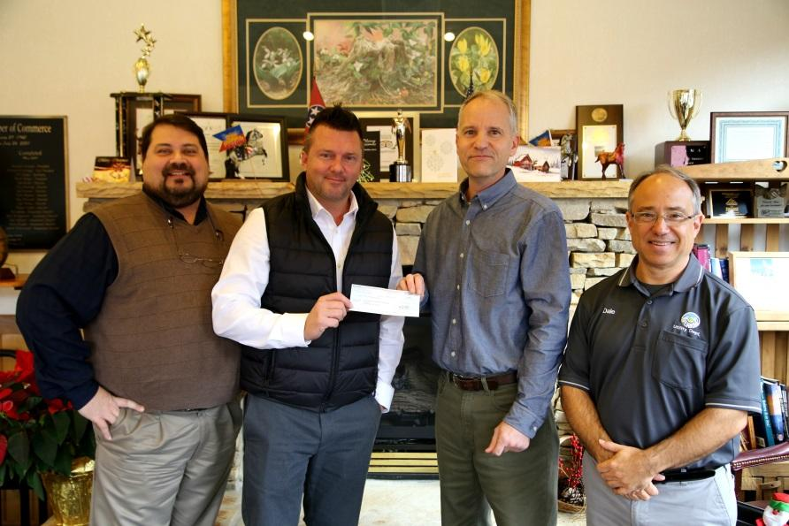 Gatlinburg, TN receives a donation from Veolia to its relief fund after a wildfire.